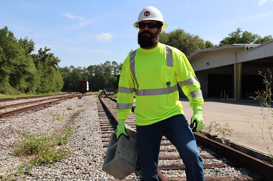 construction worker wearing hard hat hivis shirt