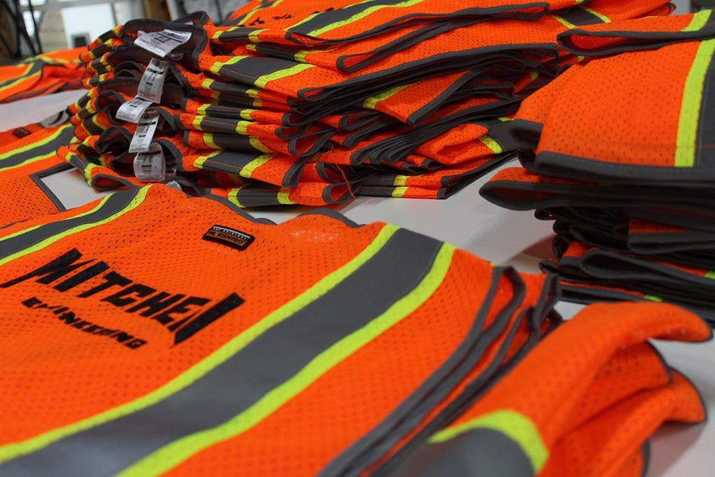 stacks of custom printed vests