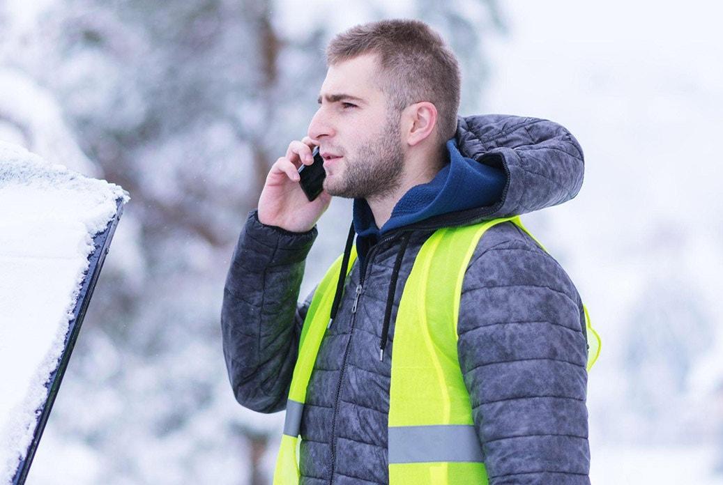 winter hi vis man on phone