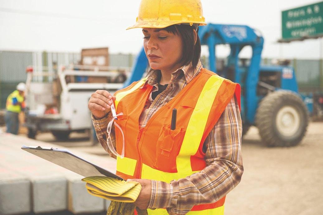woman in a surveyors vest